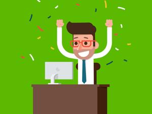 A recruiter celebrating behind desk