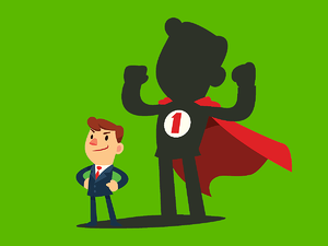 Business man with a super hero shadow behind him