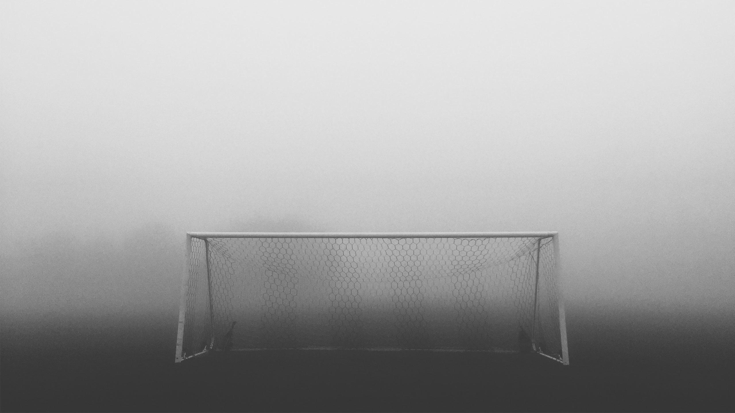 Football goal, black and white photo.