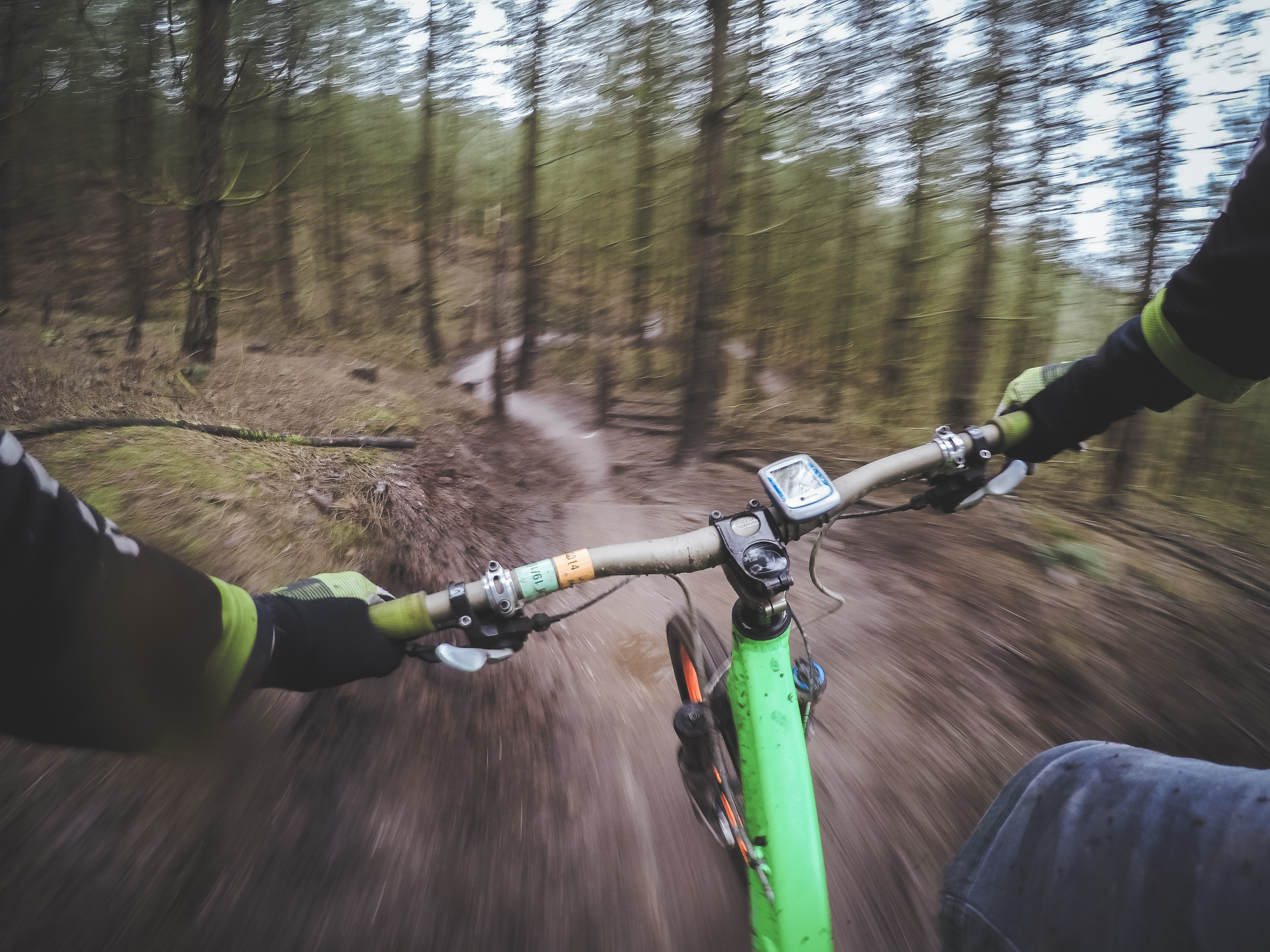 Green off road bicycle, dirt path.