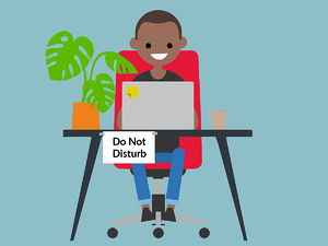 Recruiter working at home with a sign that says 'do not disturb' stuck to his desk.